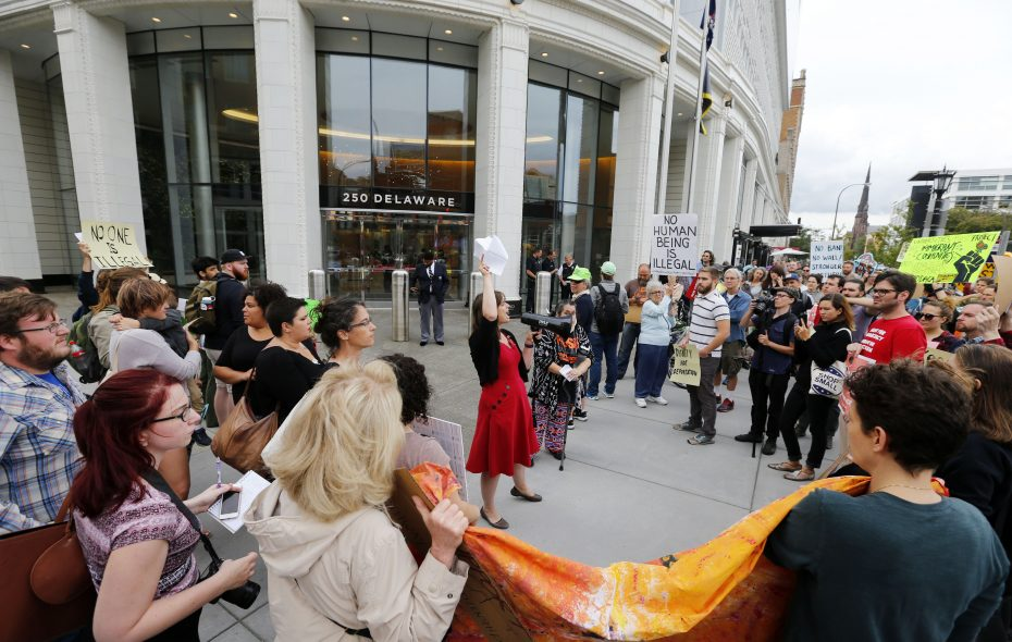 People protest DACA in front of 250 Delaware Ave. in Buffalo on Wednesday, Sept. 6, 2017. (Mark Mulville/Buffalo News)