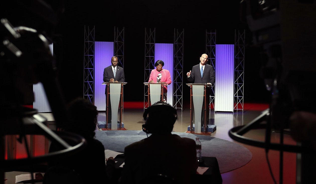 Mayor Byron Brown, Betty Jean Grant and Mark Schroeder debate at WNED studios in Buffalo on Sept. 6. (Mark Mulville/News file photo)