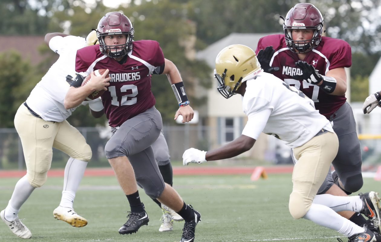 St. Joe's quarterback Casey Kelly runs for a touchdown against Cardinal O'Hara in a 41-14 win for the Marauders. (Harry Scull Jr./The Buffalo News)