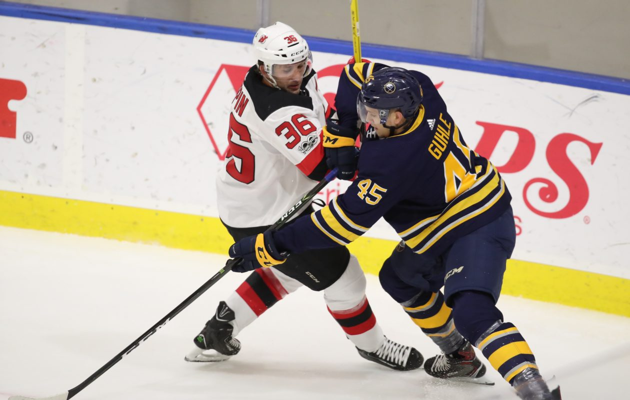 Buffalo Sabres Justin Bailey battles New Jersey's Nick Lappin for the puck in the first period at HarborCenter in Buffalo on Friday, Sept. 8, 2017. (James P. McCoy/Buffalo News)
