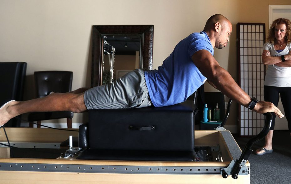 Buffalo Bills LB Lorenzo Alexander has a pilates session with Judi Donner at Symmetry Pilates Studio in Orchard Park. (Mark Mulville/News file photo)