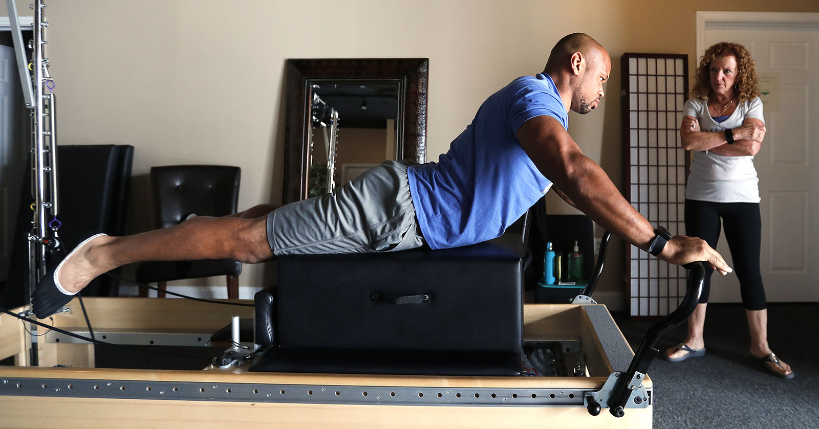 Buffalo Bills LB Lorenzo Alexander has a pilates session with Judi Donner at Symmetry Pilates Studio in Orchard Park. (Mark Mulville/Buffalo News)