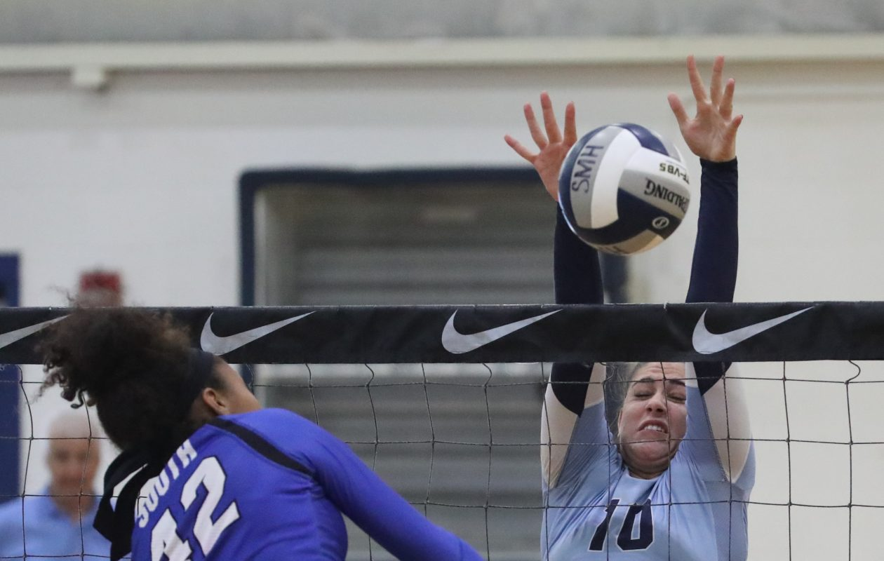 St. Mary's Caroline  Zanghi spikes the ball against Williamsville South during the Lancers' triumph at St. Mary's annual season-opening tournament last Saturday.  (James P. McCoy / Buffalo News)