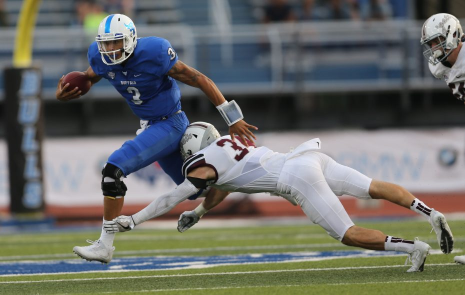 Quarterback Tyree Jackson evades a tackle in the first half of UB's 33-10 win against Colgate. (Derek Gee/Buffalo News)