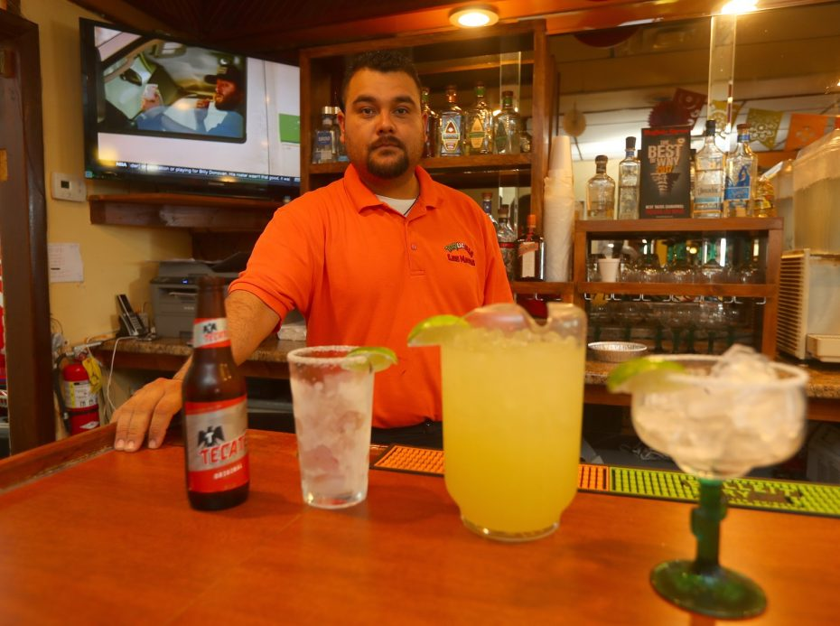 Taqueria los Mayas server Jaime Castro brings out food. (John Hickey/Buffalo News)