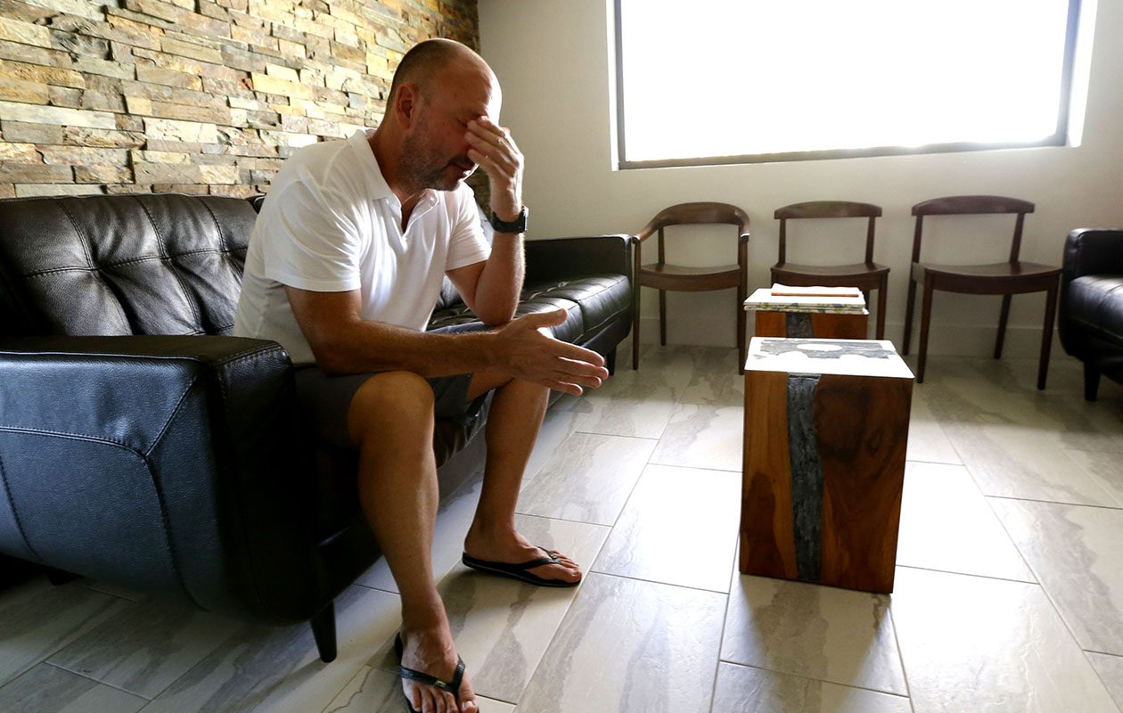 A weary Dr. Barrett Ross Ginsberg, a Buffalo native, in Naples, Fla., in his empty office during recovery from Hurricane Irma. (Robert Kirkham/Buffalo News)