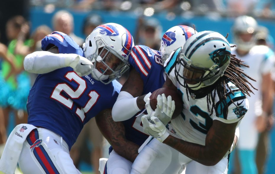 Buffalo Bills cornerback E.J. Gaines (28) and Buffalo Bills free safety Jordan Poyer (21) tackle Carolina Panthers wide receiver Kelvin Benjamin (13) after he picked up a first down in the second quarteron Sunday, Sept. 17, 2017.  (James P. McCoy/Buffalo News)