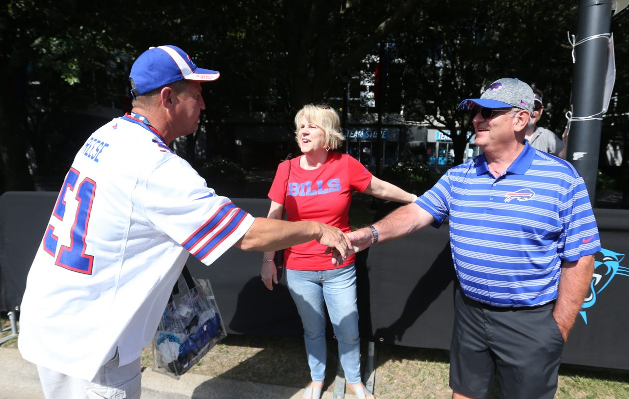 Bob and Cindy Beane talk to Bills fan Richard Reese of Buffalo in the parking lot outside Bank of America Stadium in Charlotte, N.C., on Sunday, Sept. 17, 2017.  (James P. McCoy/Buffalo News)