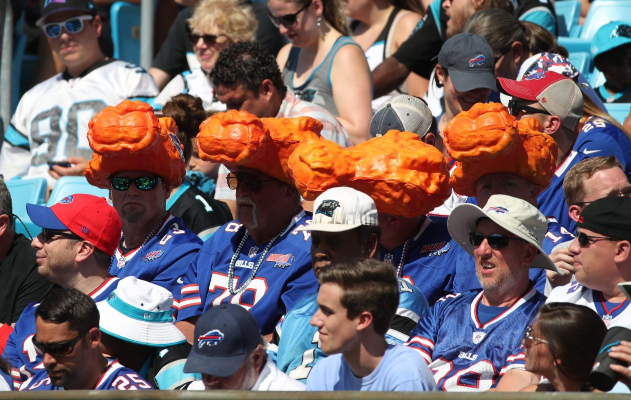 Bills fans worer chicken wing hats io last Sunday's game against the Panthers in Charlotte. (James P. McCoy / Buffalo News)