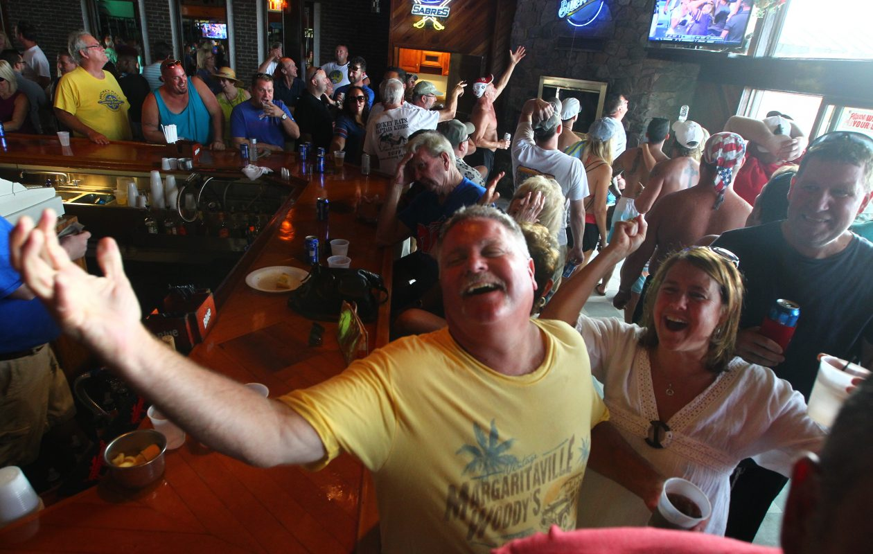 Mark Nowak, left, and his wife Trisha react with the rest of the bar to a dropped pass as they watch the Buffalo Bills game on the last day at Mickey Rats as it closes to make way for development at Mickey Rats Captain Kidds, Angola  N.Y., on Sunday, Sept. 17, 2017. (John Hickey/Buffalo News)