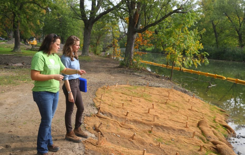 """Jill Jedlicka, executive director of Buffalo Niagara Waterkeeper, left, with senior landscape designer Erica Grohol look over the work being done on the latest """"living shoreline"""" project. (John Hickey/Buffalo News)"""