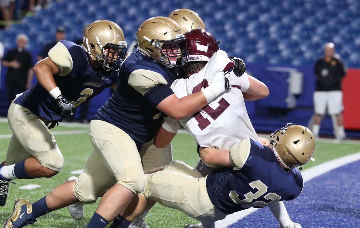 The Canisius defense made life difficult for Casey Kelly and the St. Joe's offense at New Era Field on Friday night.  (James P. McCoy / Buffalo News)