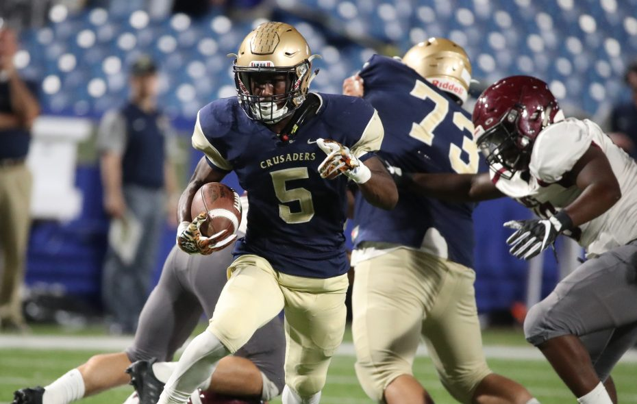Joe Jamison takes off on a 36-yard touchdown run for Canisius during the second quarter of Friday night's 55-16 triumph over St. Joe's. (James P. McCoy / Buffalo News)