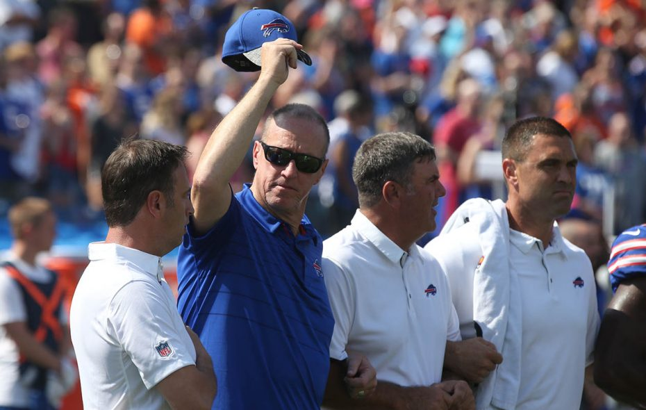 """""""I want to be clear that I agree with the reason some NFL players have chosen to peacefully protest, and appreciate players, coaches and organizations being unified,"""" Jim Kelly, shown here during Sunday's national anthem, told the Associated Press. (James P. McCoy/News file photo)"""