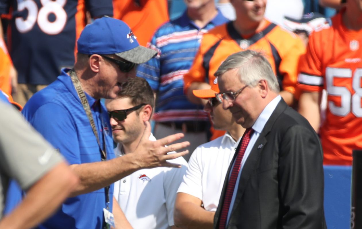 Bills Hall of Famer Jim Kelly talks to team owner Terry Pegula before the Sept. 25, 2017, game. (James P. McCoy/News file photo)