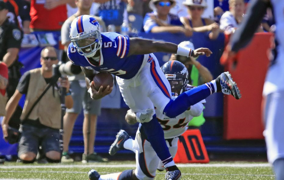 Buffalo Bills quarterback Tyrod Taylor drags Denver Broncos Will Parks during the third quarter of Sunday's game at New Era Field . (Harry Scull Jr./ Buffalo News)