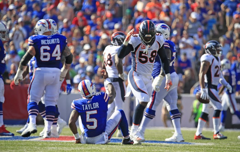 Denver Broncos linebacker Von Miller (58) pulls his hand away at the last moment after offering to help Buffalo Bills quarterback Tyrod Taylor (5) up off the ground during the fourth quarter at New Era Field on Sunday, Sept. 24, 2017.  Miller was penalized on the play. (Harry Scull Jr./ Buffalo News)