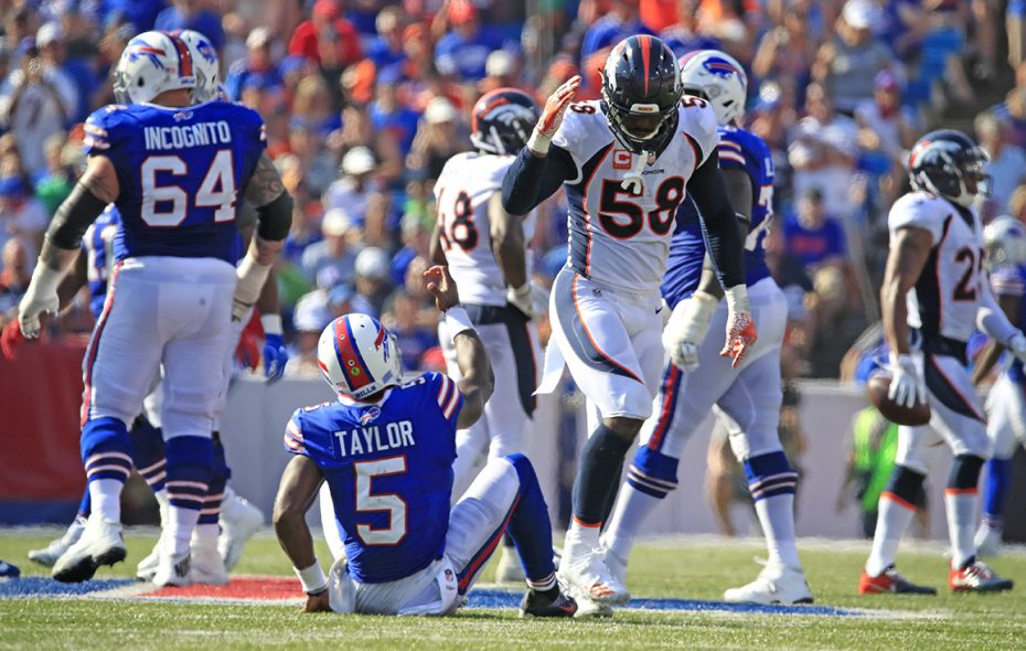 Broncos linebacker Von Miller pulls his hand away at the last moment after offering to help Bills quarterback Tyrod Taylor up off the ground during the Sept. 24 game at New Era Field. Miller was penalized on the play. (Harry Scull Jr./Buffalo News)