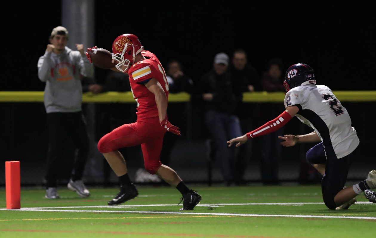 Williamsville East's Joey Shifflet scores the game-tying touchdown in a 23-22 Flames win against North Tonawanda. (Harry Scull Jr./Buffalo News)
