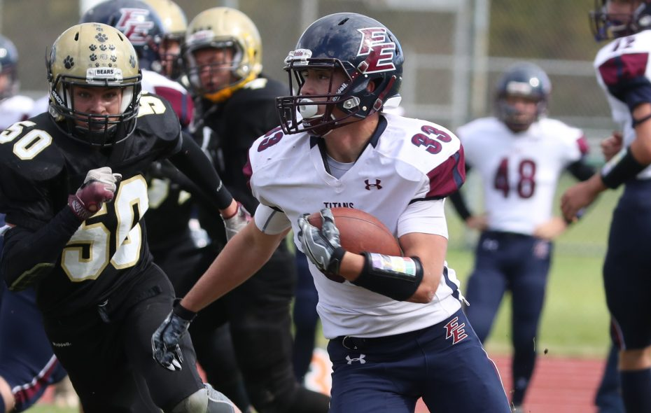 Franklinville/Ellicottville's Griffin Chudy picks up some yards during the sixth-ranked Titans' win at JFK on Saturday.  (James P. McCoy / Buffalo News)