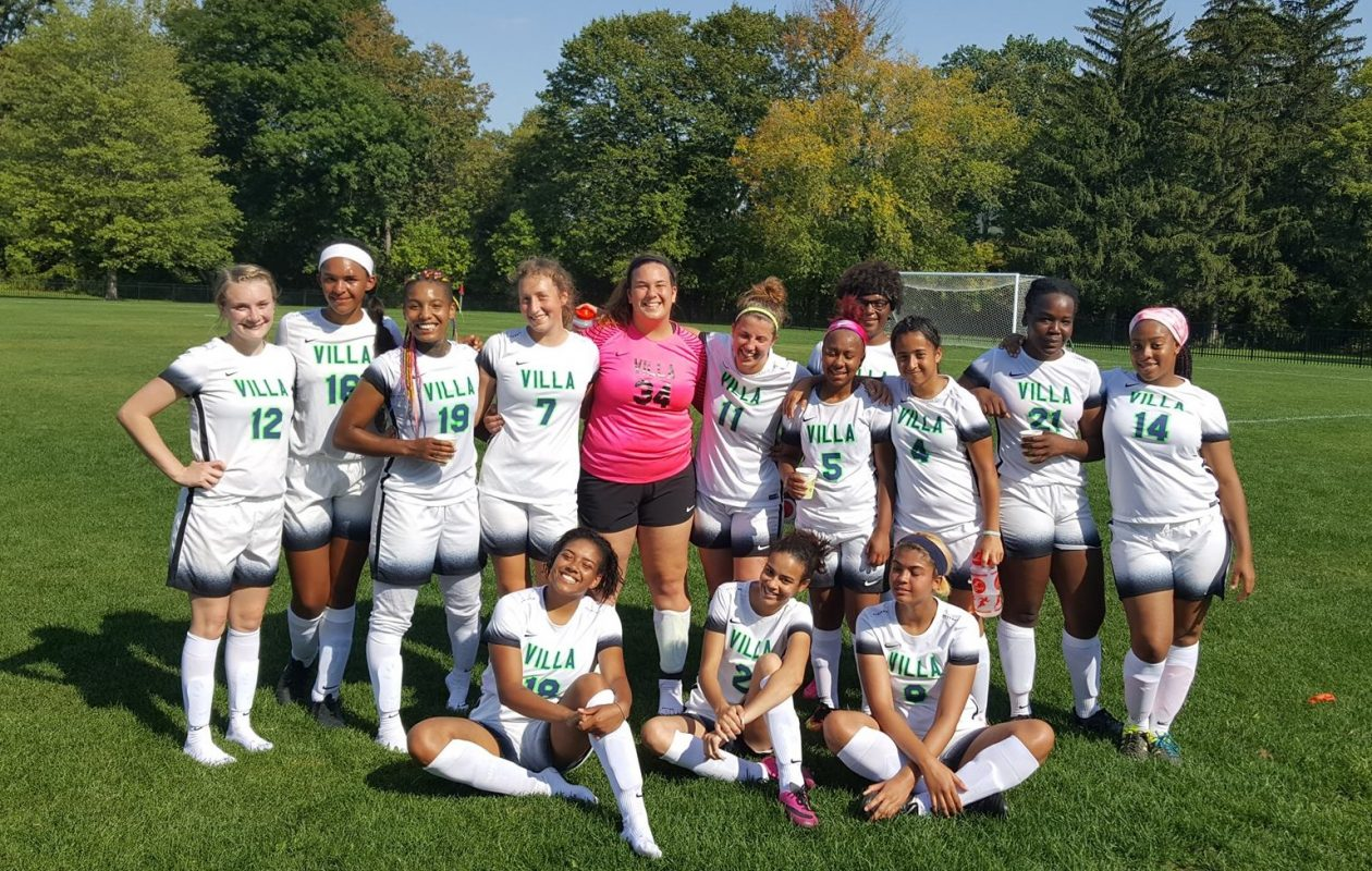 The Villa Maria women's soccer team poses after securing the first win in program history. (via Villa Maria)
