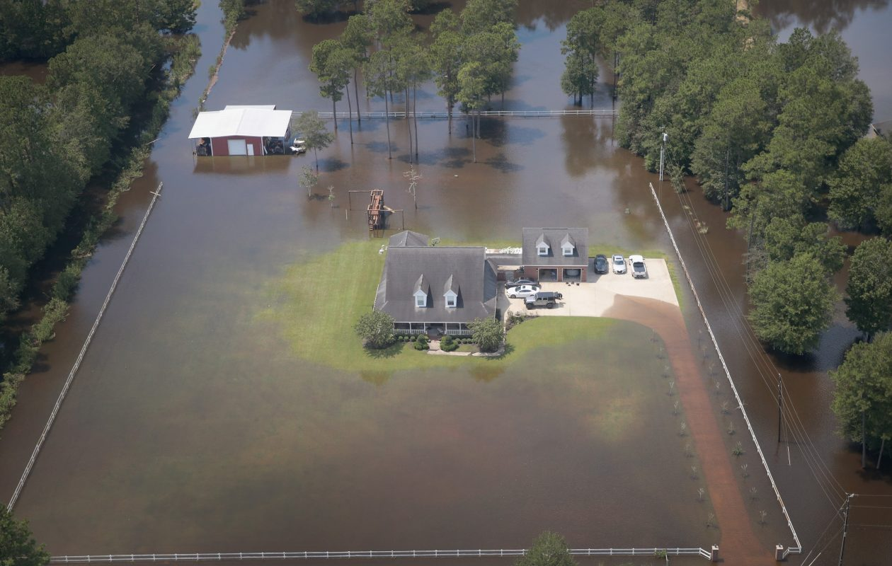 A home is surrounded by floodwater after torrential rains pounded Southeast Texas following Hurricane and Tropical Storm Harvey on August 31, 2017 near Orange, Texas.  (Getty Images)