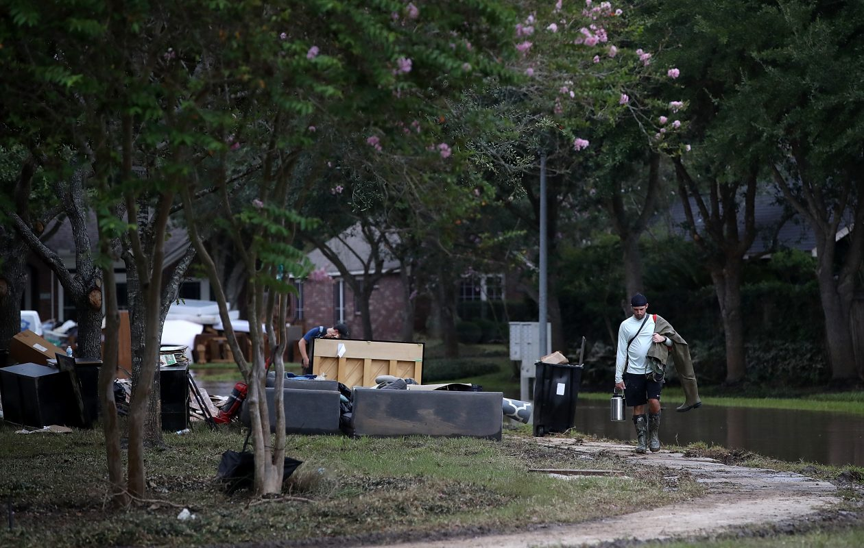 As Irma is upgraded to a dangerous Category 5 Hurricane, the cleanup from Harvey continues in southern Texas. Here, a resident walks through a flooded neighborhood in Katy, Texas, on Monday. (Getty Images)