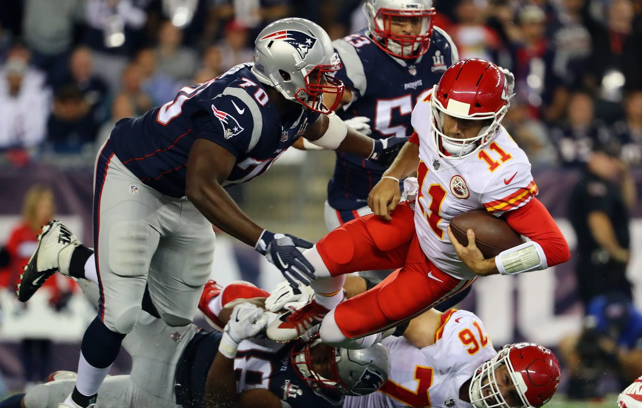 Alex Smith #11 of the Kansas City Chiefs is sacked during the second half by the New England Patriots at Gillette Stadium on Sept. 7, 2017, in Foxboro. (Photo by Adam Glanzman/Getty Images)