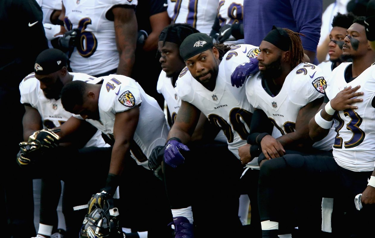 Baltimore Ravens players kneel for the American national anthem during the NFL International Series match between Baltimore Ravens and Jacksonville Jaguars at Wembley Stadium on Sept. 24, 2017, in London.  (Photo by Alex Pantling/Getty Images)