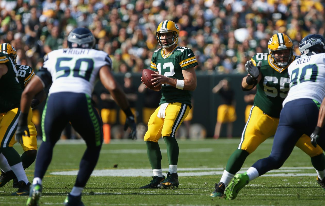 Aaron Rodgers and the Packers look to make a statement against the Falcons. (Dylan Buell/Getty Images)