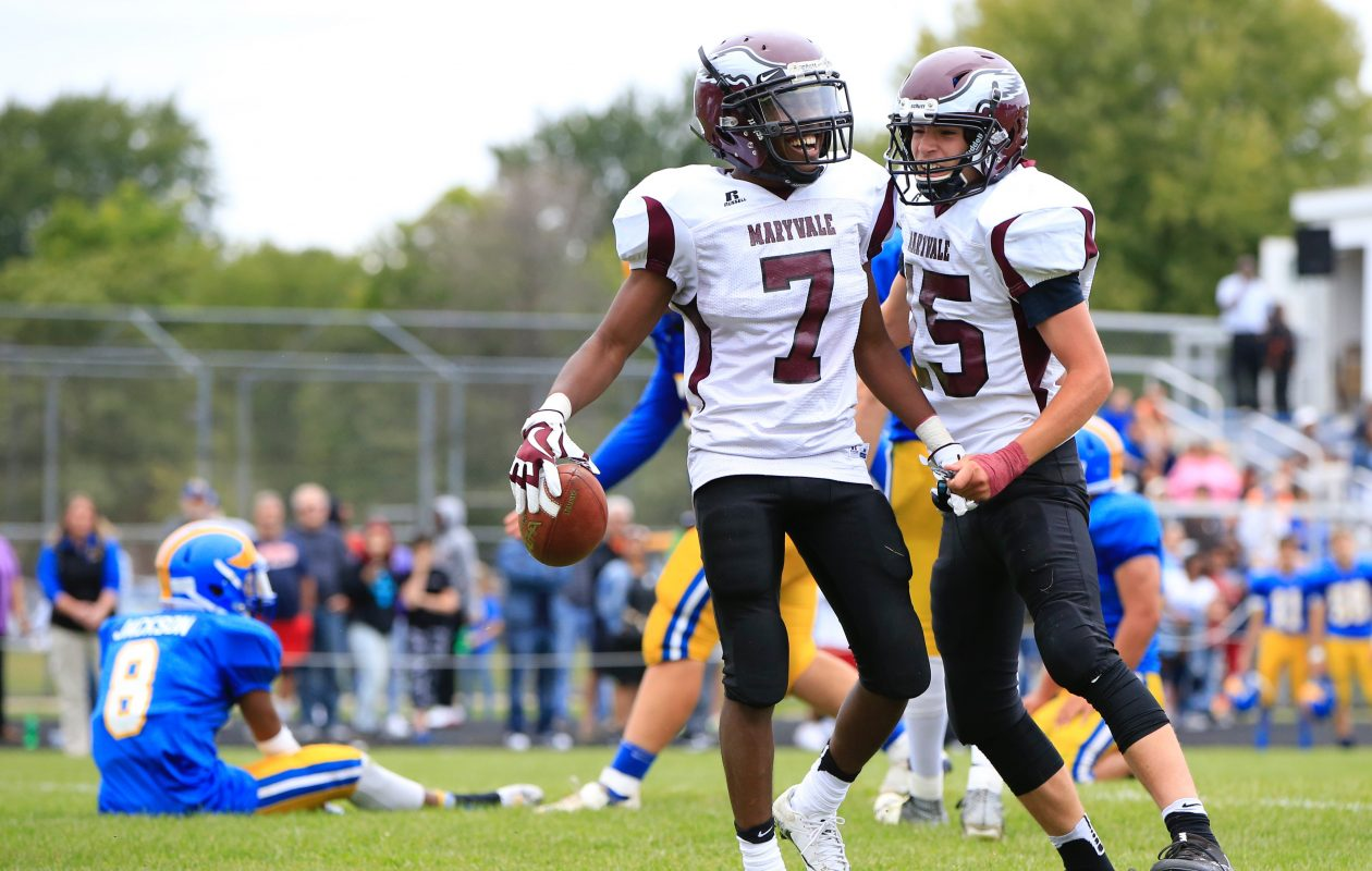 Ray Blackwell and quarterback Connor Desiderio, right, celebrate Blackwell's go-ahead touchdown catch Saturday at Cleveland Hill's Carl J. Kuras Field. (Harry Scull Jr./Buffalo News)