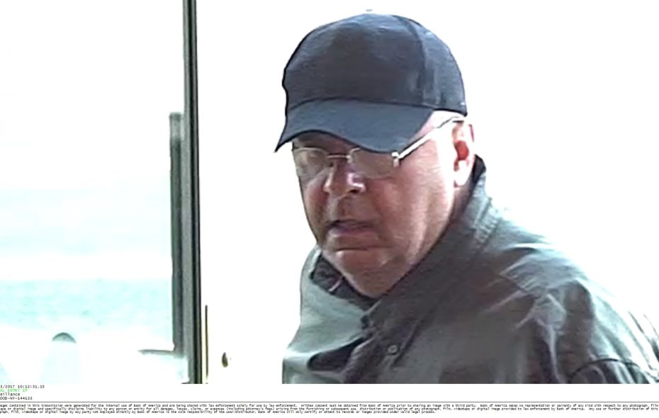 Harry Charnock, pictured in this surveillance camera image, pleaded guilty to robbing a Bank of America branch on Elmwood Avenue in  September. (Provided by Buffalo Police.)