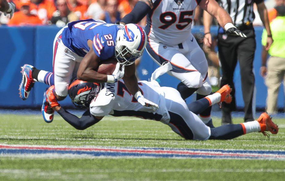 Bills running back LeSean McCoy is tackled by Denver Broncos safety Justin Simmons. (James P. McCoy / Buffalo News)
