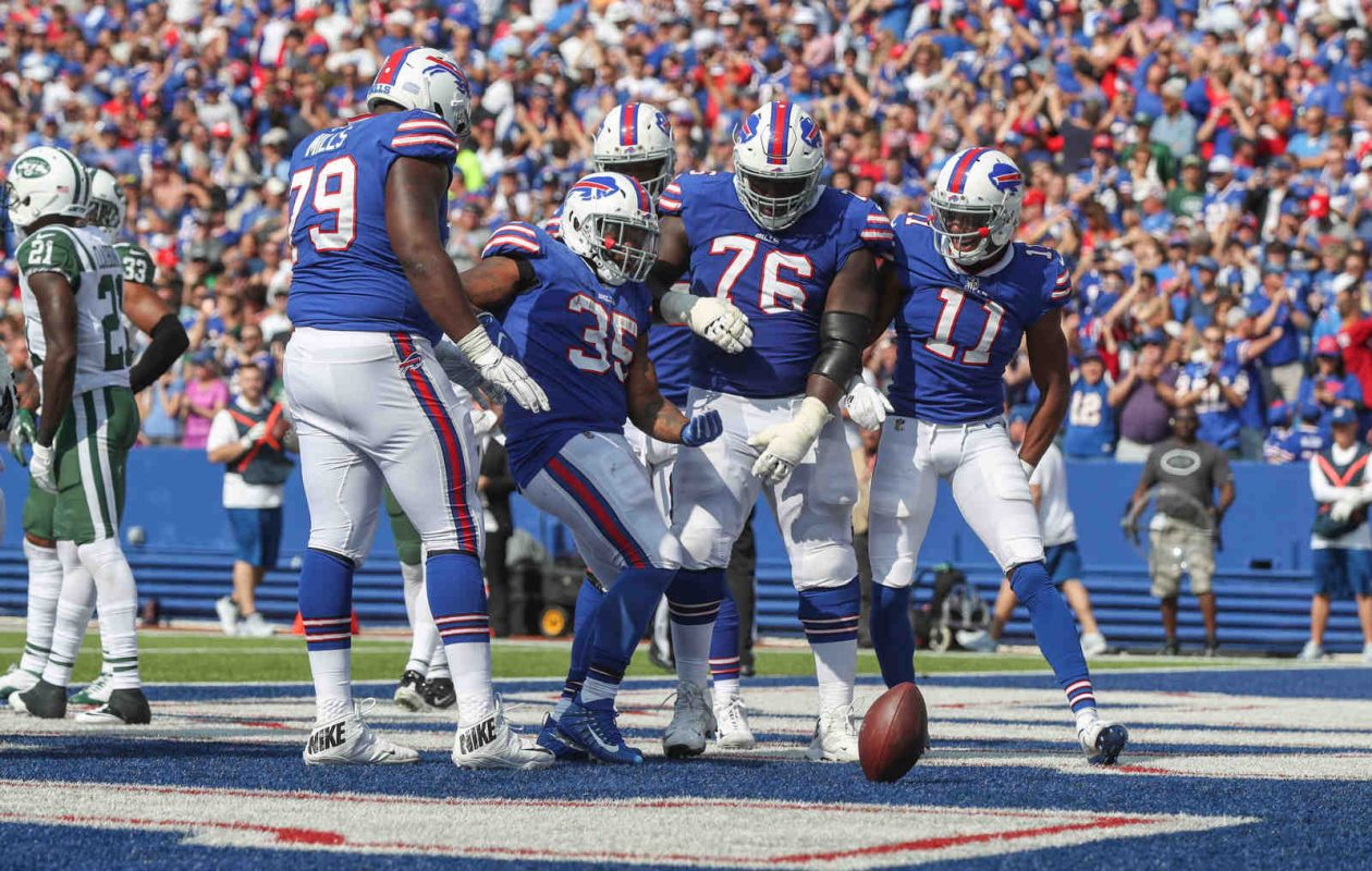 Running back Mike Tolbert (35) celebrates his touchdown Sunday against the Jets. (James P. McCoy/Buffalo News)
