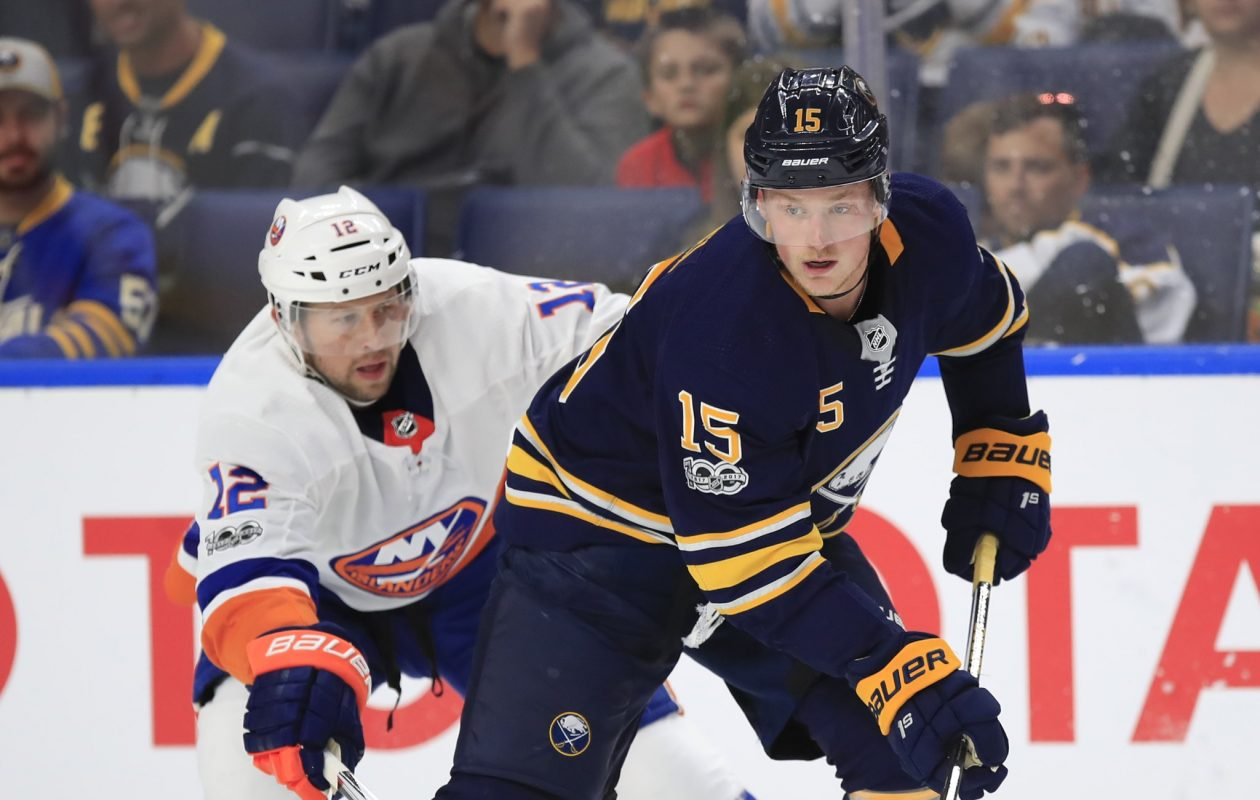 The Sabres' Jack Eichel shields New York's Josh Bailey from the puck Friday night. (Harry Scull Jr./Buffalo News)