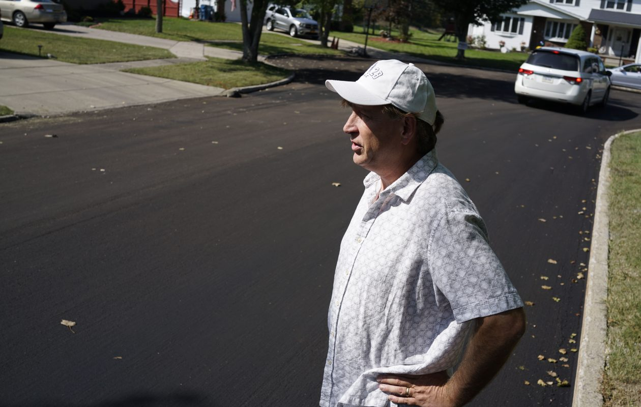 Grand Island resident Don Keller is among many unhappy with the new road surface put on Fareway Lane by Suit-Kote. He pointed out defects in the surface on  Thursday, Sept. 21, 2017.   (Derek Gee/Buffalo News)