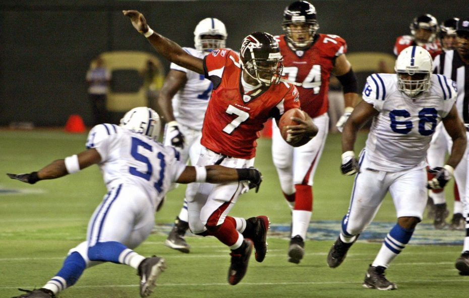 Atlanta Falcons quarterback Michael Vick is tackled by Indianapolis Colts Gilbert Gardner (L, 51#) during their pre-season match at the Tokyo Dome, 06 August 2005.  After the 2nd quarter, Falcons was leading  20-14 against Colts.   (Getty Images)