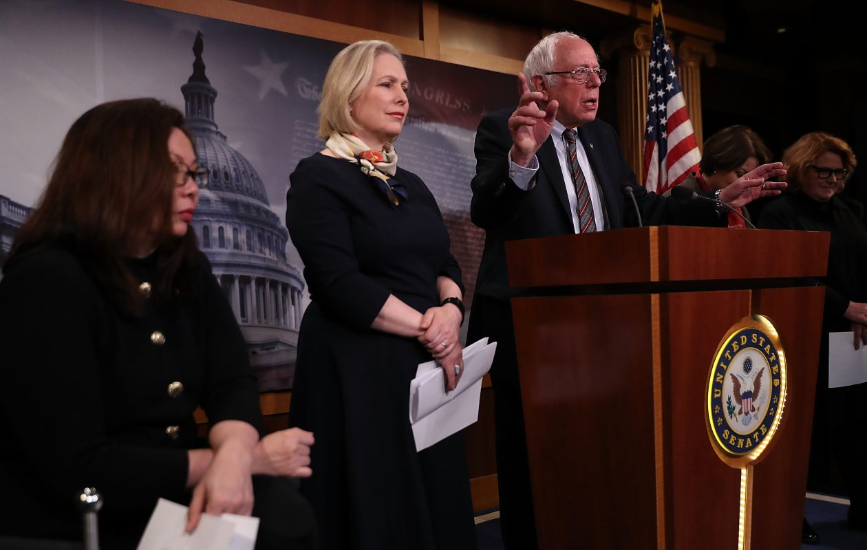 Sen. Bernie Sanders (R) (I-VT) speaks as Sen. Kirsten Gillibrand (C) (D-NY) and Sen. Tammy Duckworth (L) (D-MN) look on during a news conference at the U.S. Capitol on March 14, 2017.(Photo by Justin Sullivan/Getty Images)