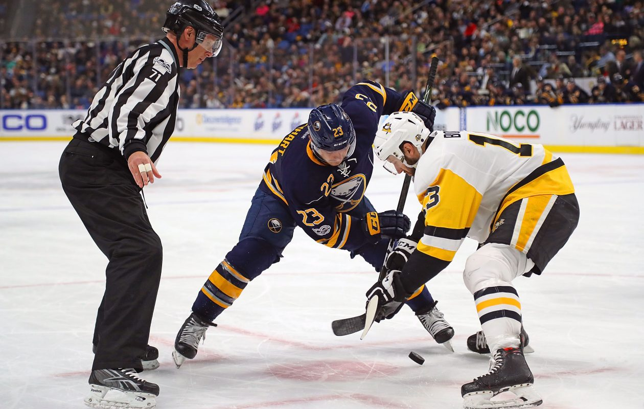 Buffalo's Sam Reinhart and other NHL centers must stay behind the red lines on draws or be penalized. (NHLI via Getty Images)