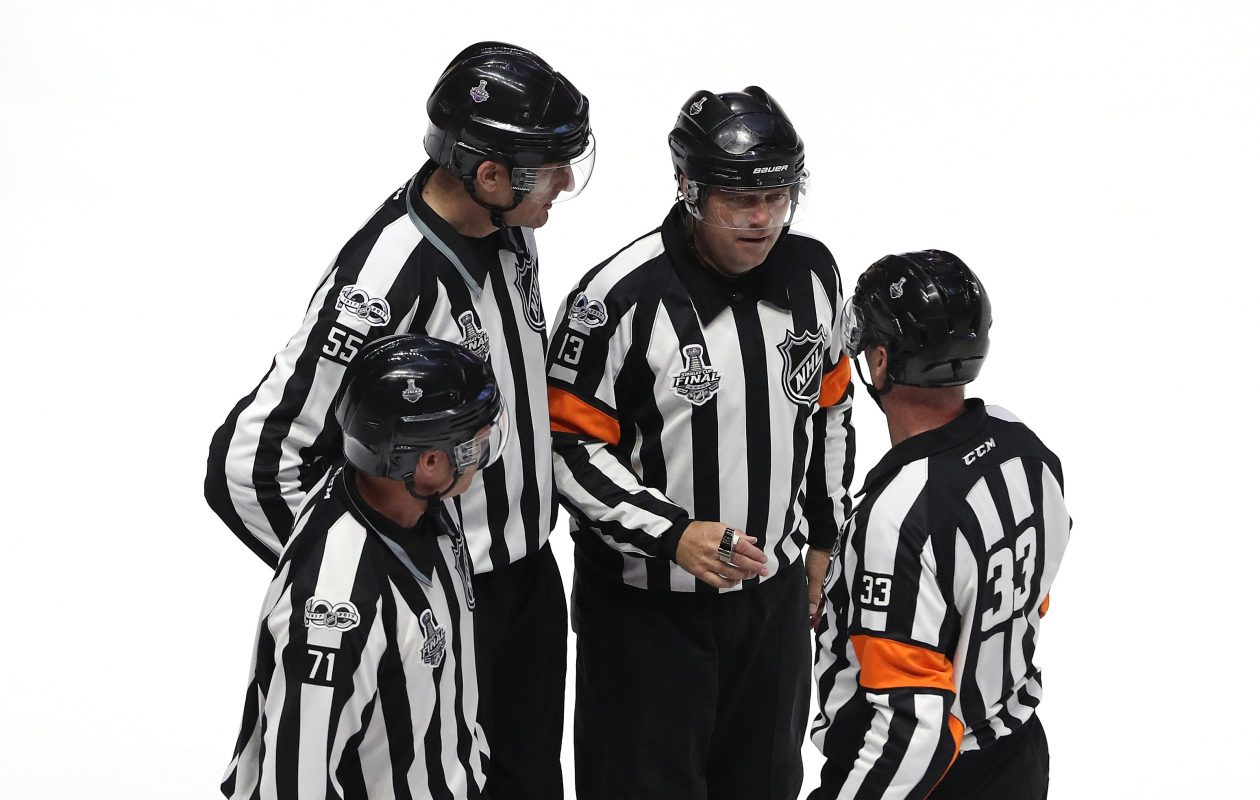 NHL referees, like the ones shown during the Stanley Cup final, have whistled the Sabres for 21 penalties in three preseason games. (Getty Images)