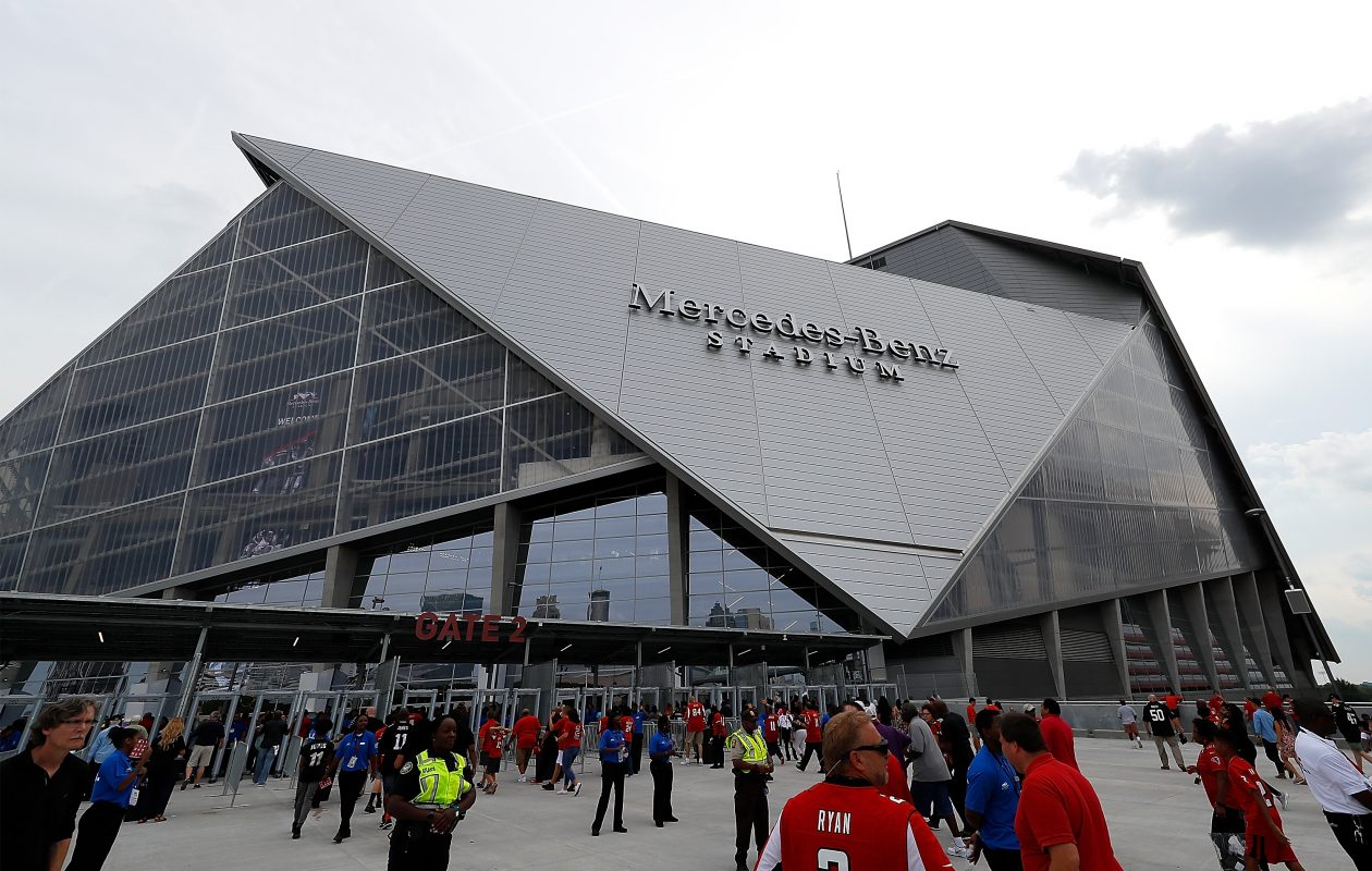 Fans enter the gates at Mercedez Benz Stadium  (Kevin C. Cox/Getty Images)
