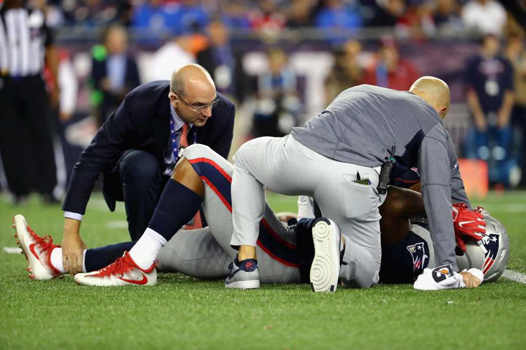 Dont'a Hightower #54 of the New England Patriots is helped by training staff after suffering an injury during the second half against the Kansas City Chiefs at Gillette Stadium on Sept. 7, 2017, in Foxboro. (Photo by Adam Glanzman/Getty Images)