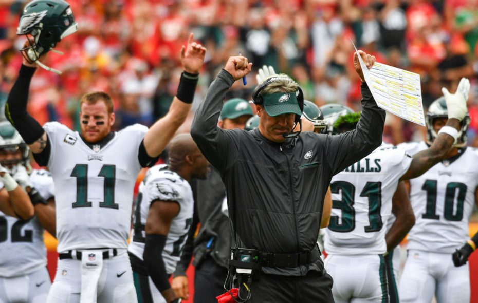 Head coach Doug Pederson and Carson Wentz #11 of the Philadelphia Eagles put their arms up after a successful coaches challenge leads to a touchdown in the third quarter the game against the Kansas City Chiefs on Sept. 17, 2017. (Getty Images)