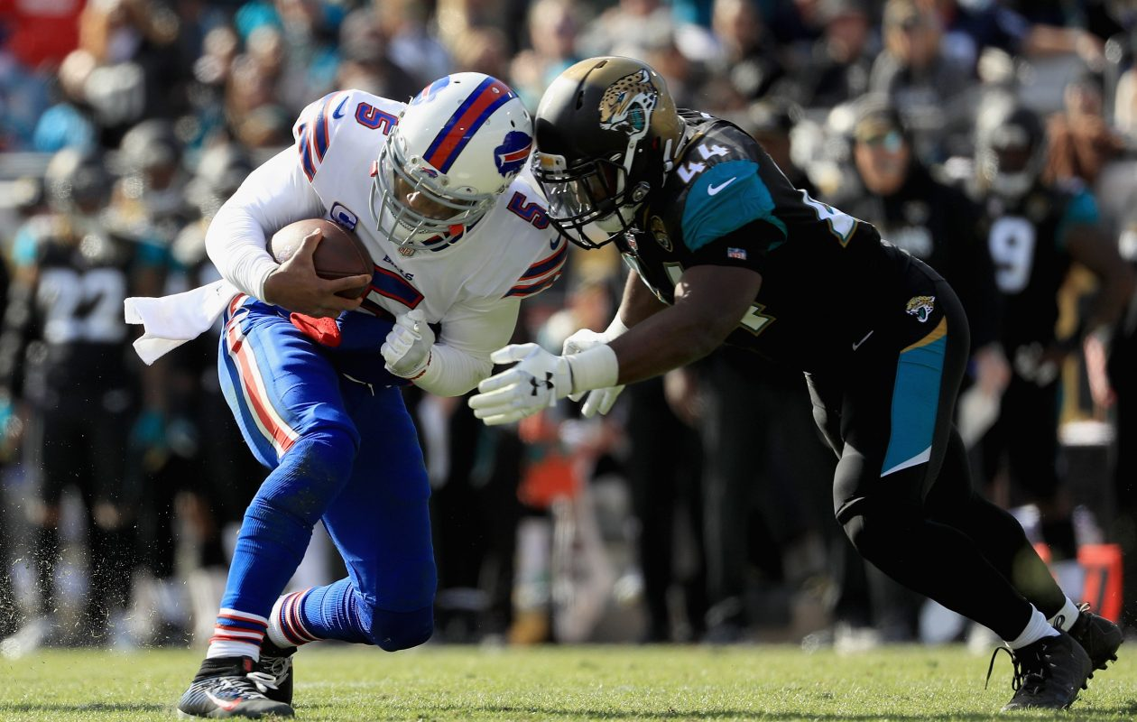 Outside linebacker Myles Jack (44) of the Jacksonville Jaguars tackles quarterback Tyrod Taylor (5) of the Buffalo Bills in the second quarter (Getty Images)