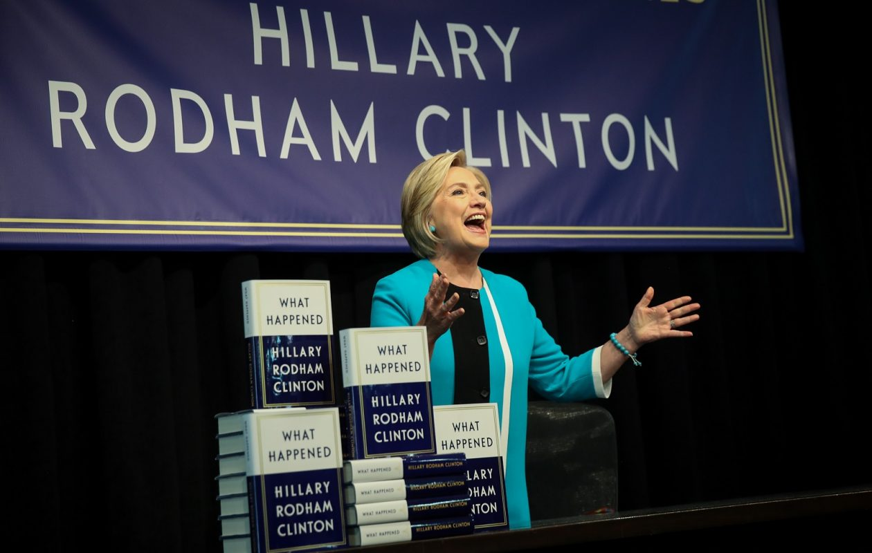 Former U.S. Secretary of State Hillary Clinton acknowledges the audience as she arrives onstage to sign copies of her new book 'What Happened' during an event at Barnes and Noble bookstore earlier this month in New York City. (Drew Angerer/Getty Images)