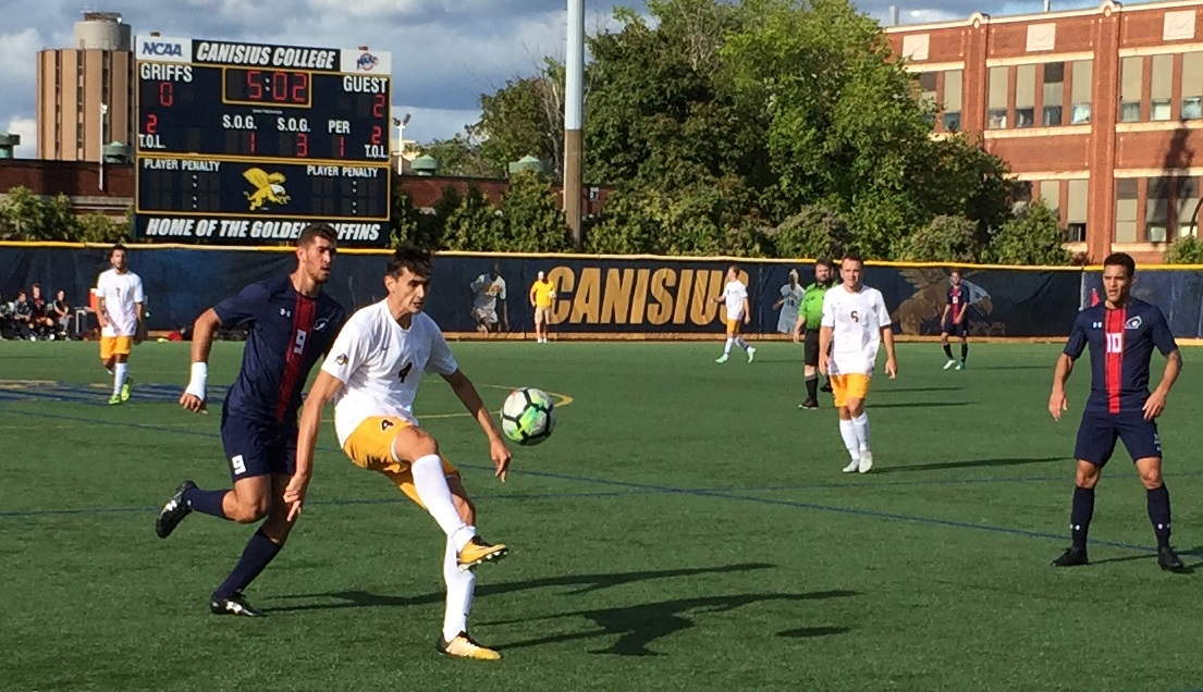 Alex Grattarola, Canisius' 6'6 center back, knocks a ball forward. (Ben Tsujimoto/Buffalo News file photo)