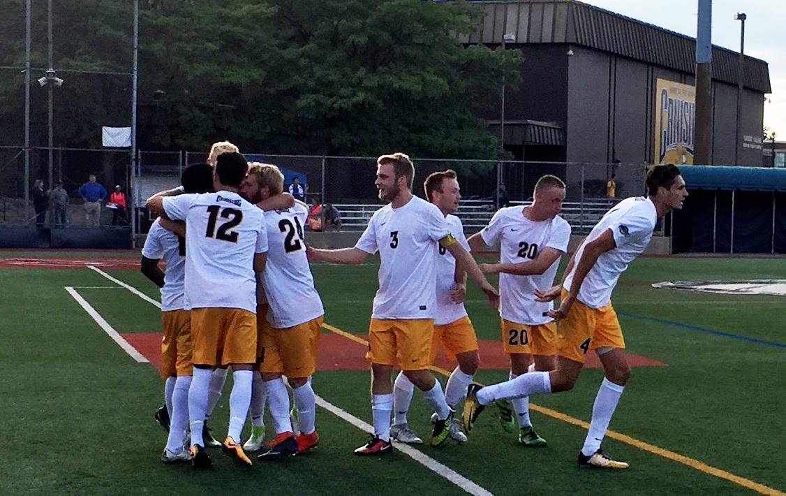The Canisius Griffins men's soccer team celebrates a goal by Melvin Blair. (Ben Tsujimoto/Buffalo News)