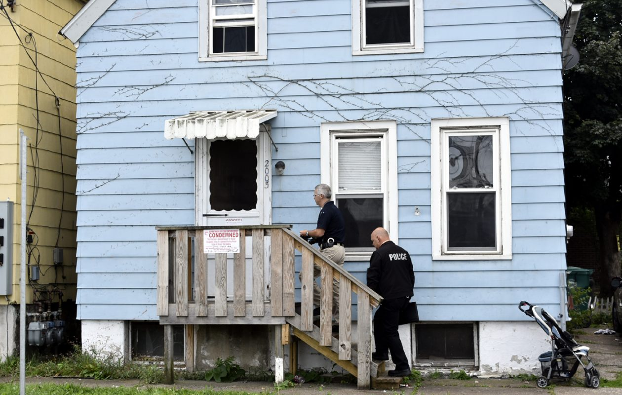 Niagara Falls police enter 2003 Walnut St. after an 11-month-old boy was injured falling from a second-floor window of the home on Wednesday, Sept. 13, 2017. (Larry Kensinger / Special to The Buffalo News)