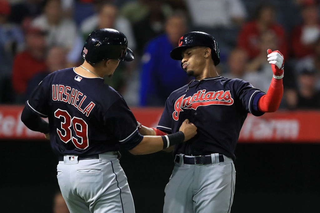Cleveland's Francisco Lindor, right, gets greeted by Giovanny Urshela after his two-run home run Wednesday in Anaheim. Lindor has 31 homers this season, most by a switch-hitting shortstop in history (Getty Images).