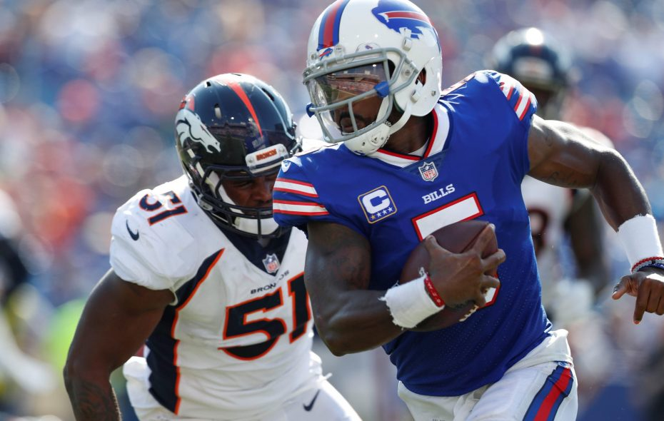 Buffalo Bills quarterback Tyrod Taylor rushes the ball as he is pressured by Denver Broncos linebacker Todd Davis (51) during the third quarter at New Era Field in Orchard Park on Sunday, Sept. 24, 2017.  (Mark Mulville/Buffalo News)